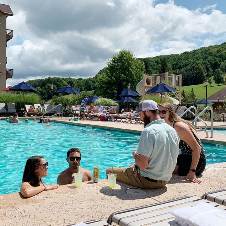 2 couples at the Holiday Valley summer pools