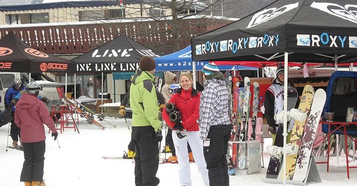 Skiers and snowboarders getting free demos on Demo Day