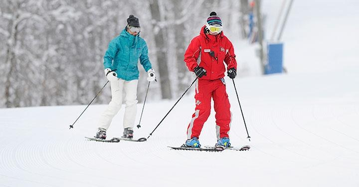 ski instructor and student