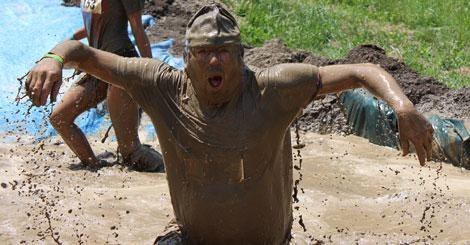 very muddy man at Mudslide finish
