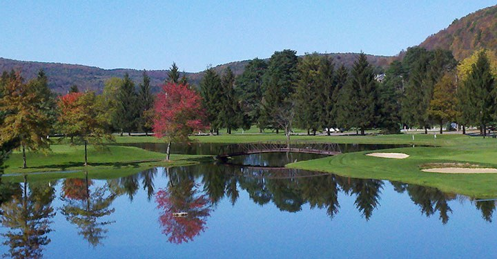 golf course and pond with fall colors