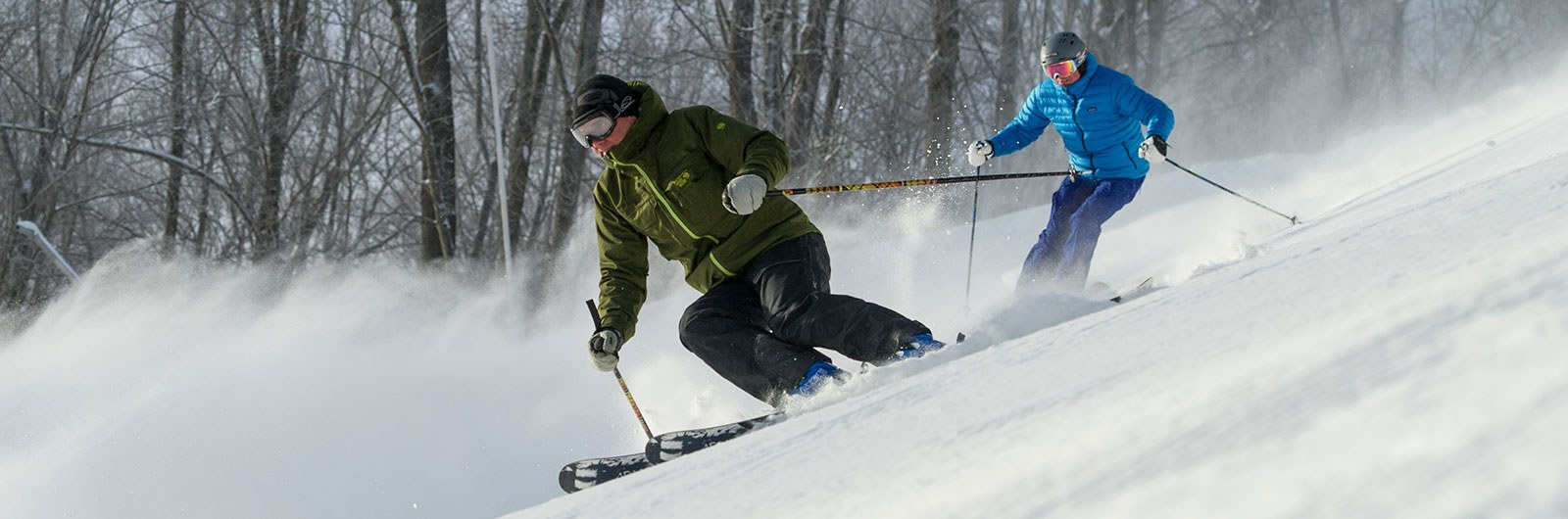 Two men skiing on a steep slope