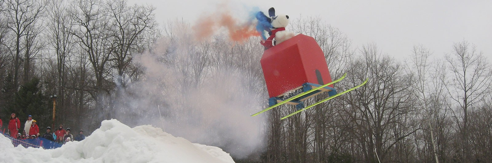 Snoopy and doghouse over jump at Dummy Downhill event