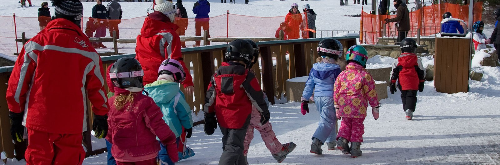 kids heading to their ski lesson