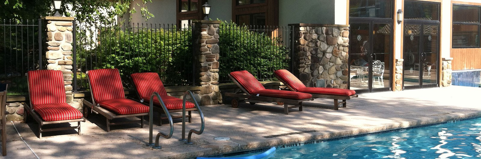 lounge chairs at the Inn pool in the summer