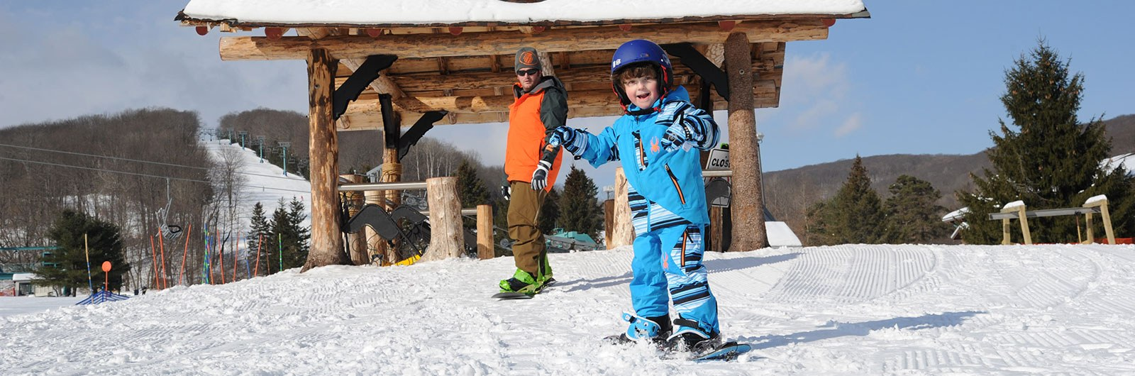 Child learning to snowboard