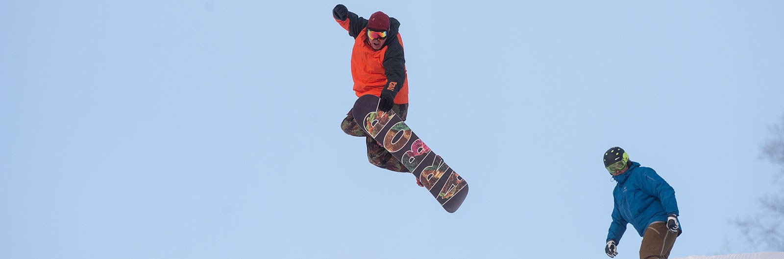 Snowboarder in the air off a jump