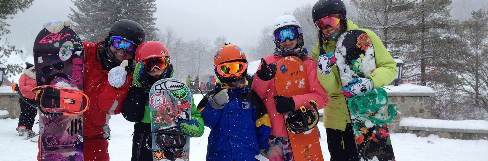 Thumbs up from Snowboarding Kids and instructor