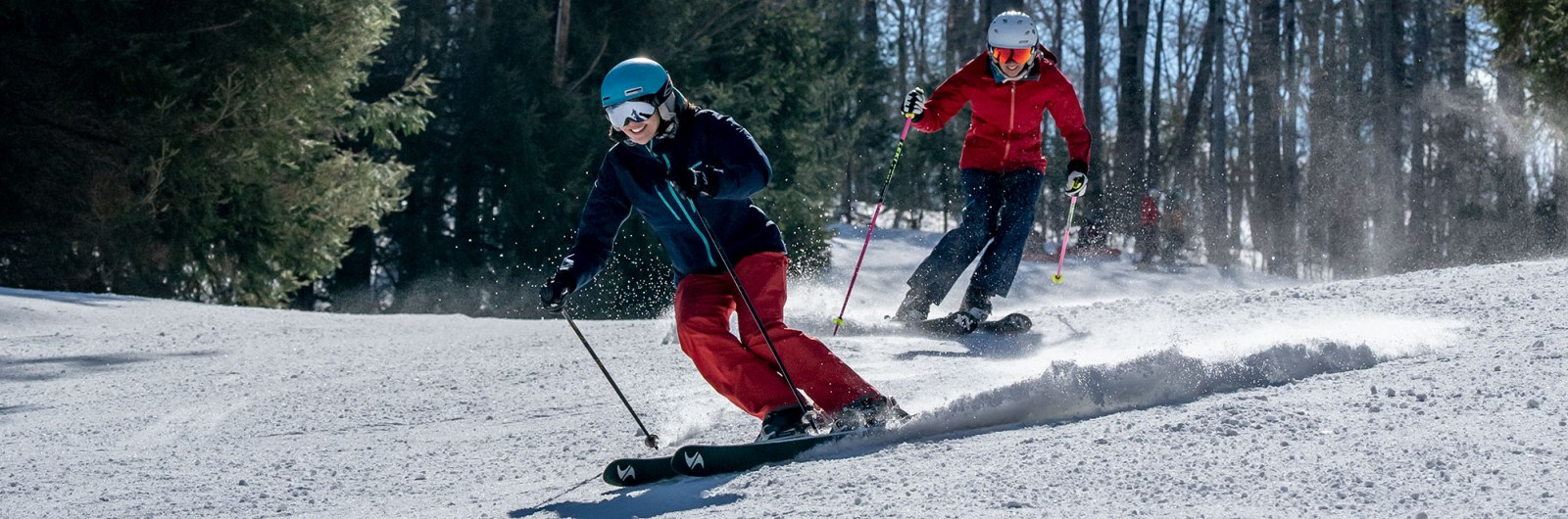 Women carving down the ski mountain at Holiday Valley resort in New York