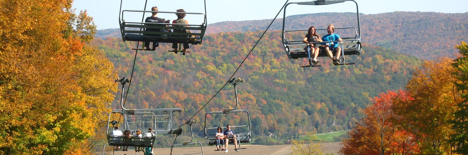People enjoying Fall chairlift rides