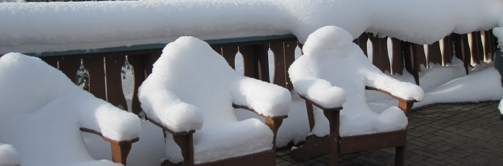 Chairs on deck covered in fresh snow