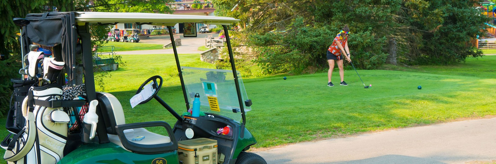 Woman about to tee off on golf course