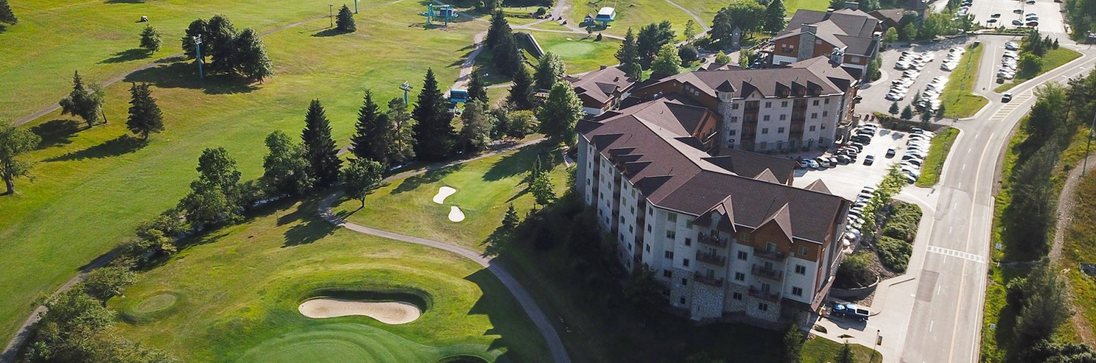 Aerial view of golf course and lodge at Holiday Valley on a Summer day