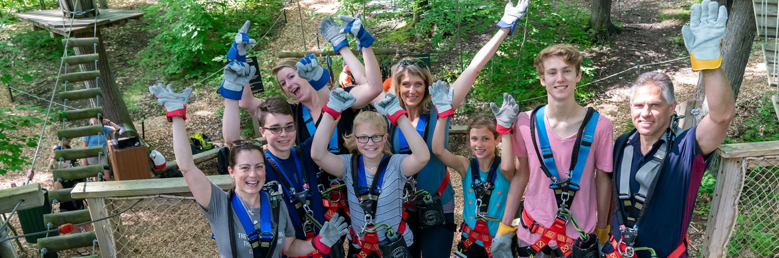 Family group in zip line harnesses at Sky High Adventure park