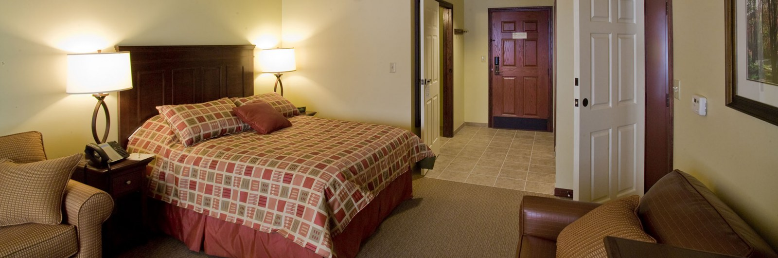 Queen size hotel room at the Tamarack Club in Ellicottville New York