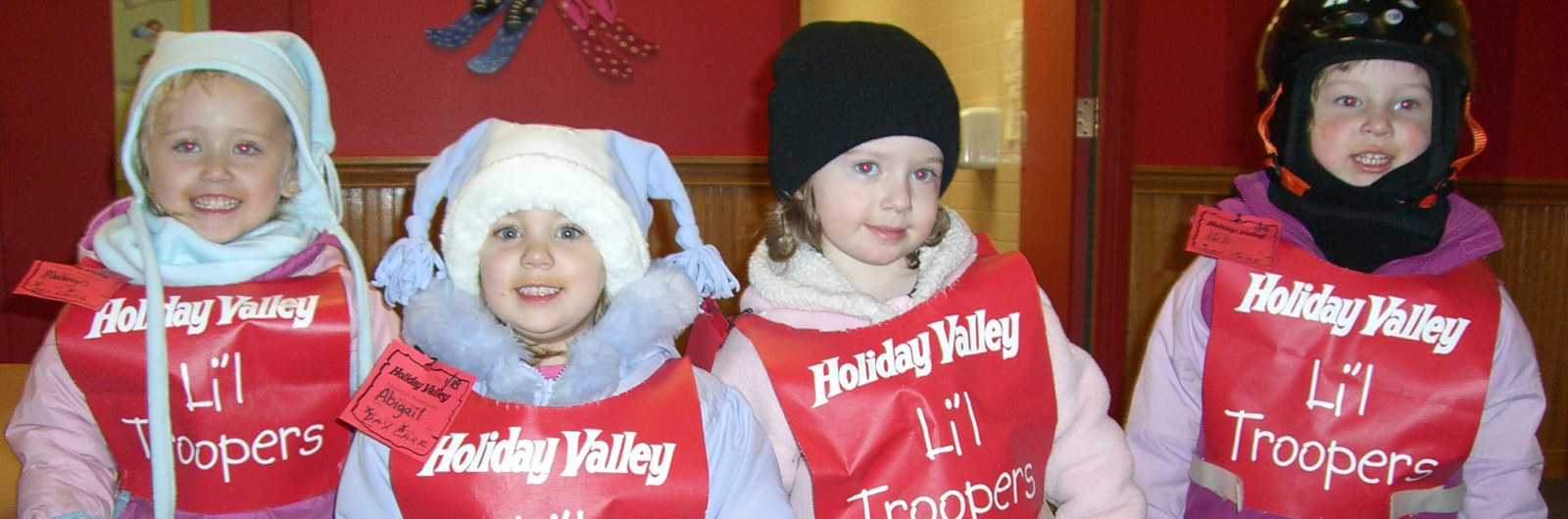 Four young children in snowsuits at Holliday Valley daycare