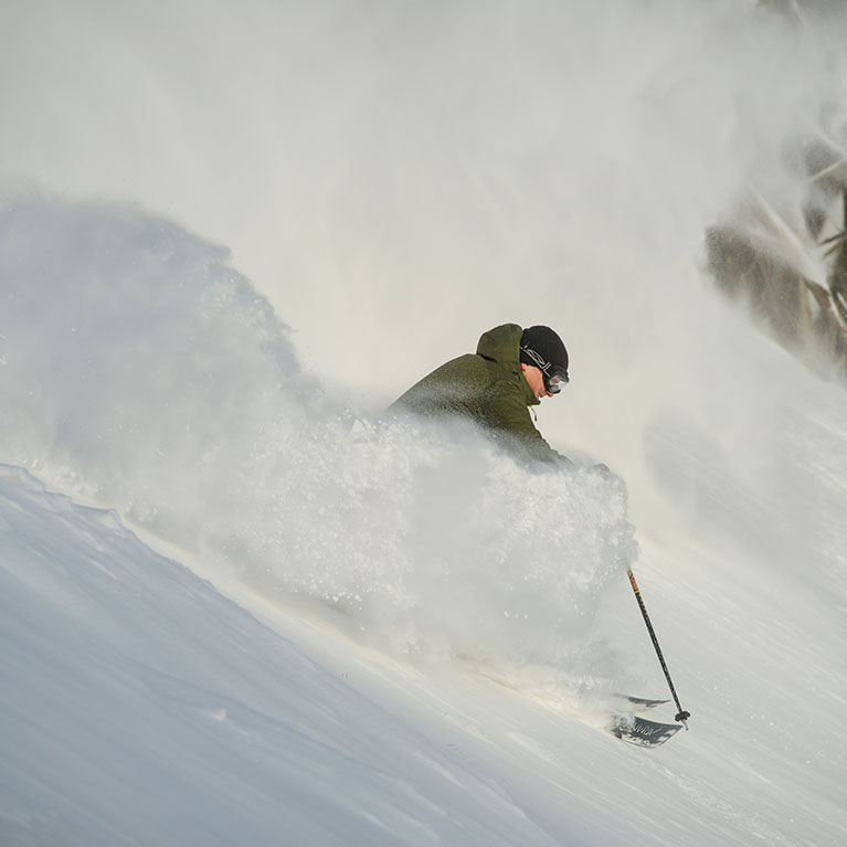 man skiing in deep powder