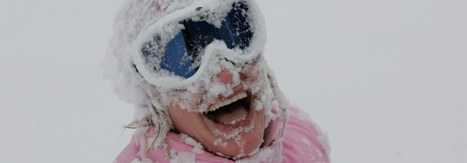 Woman laughing with snow on her face