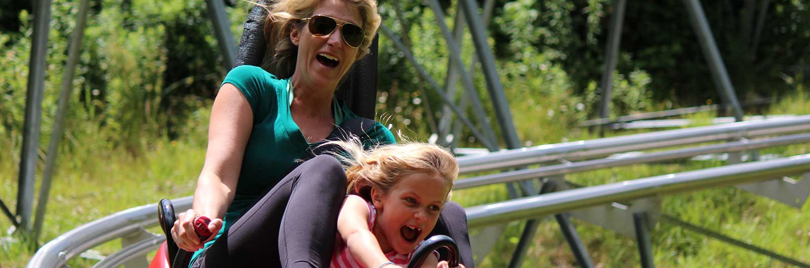 Mother and daughter on Mountain Coaster