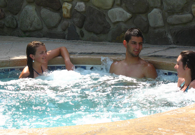 three people in the hot tub at the Inn at Holiday Valley