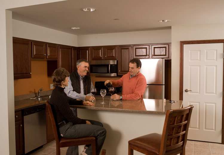 1 bedroom 6 kitchen with guests enjoying wine