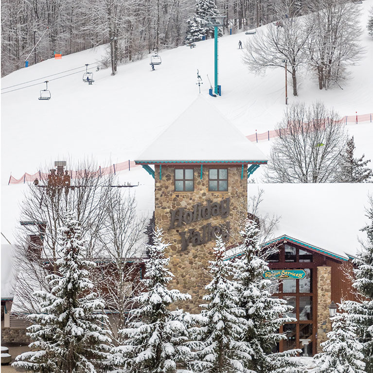 Snowy RSC Lodge with Mardi Gras slope in background