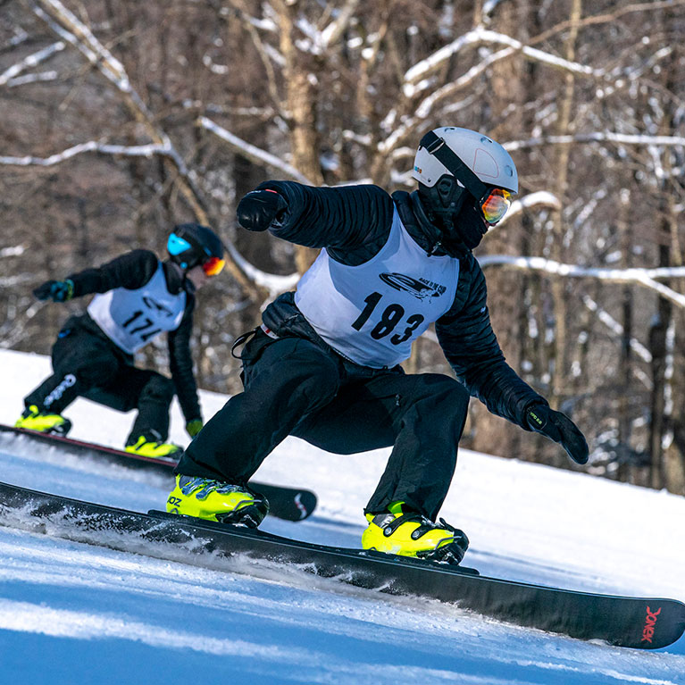 Skiers competing in a parallel slalom race