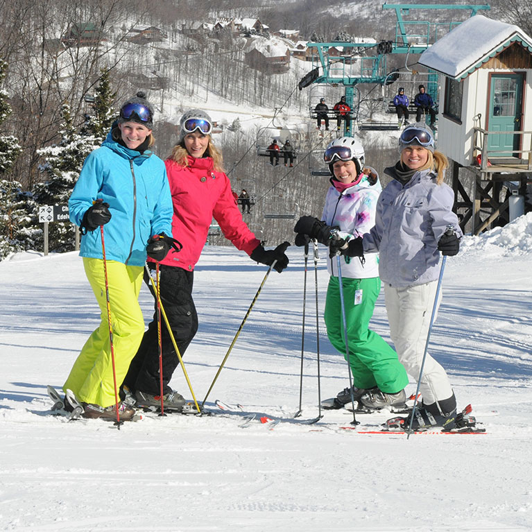 Group of women skiers posing for photo on the slopes