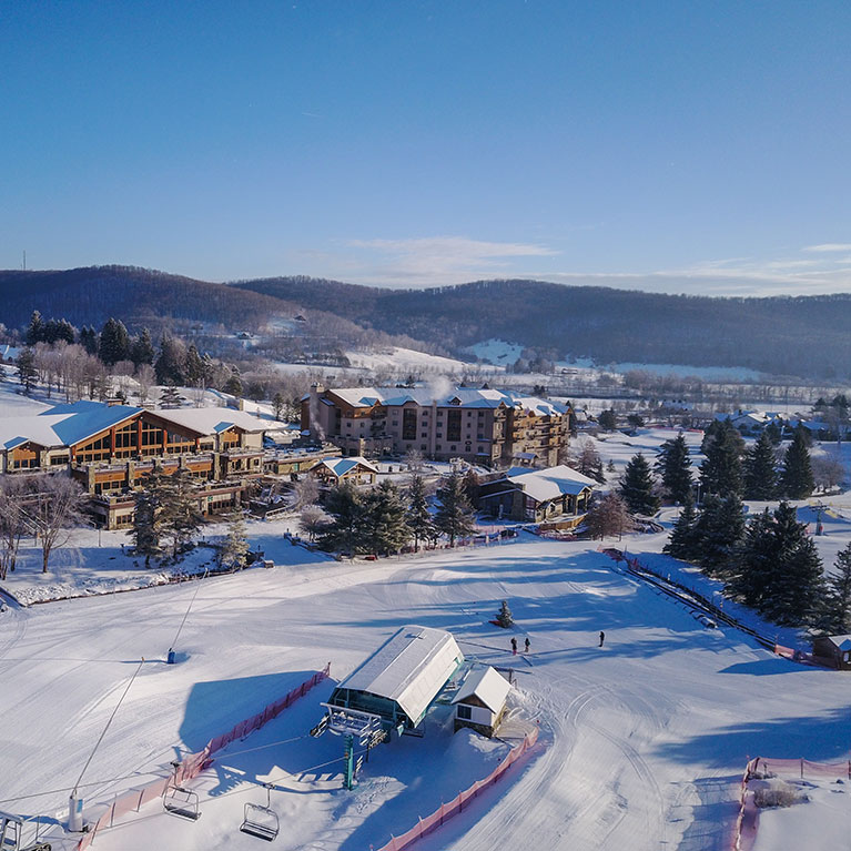 Aerial view of Holiday Valley base lodge and hotel on a Winter day