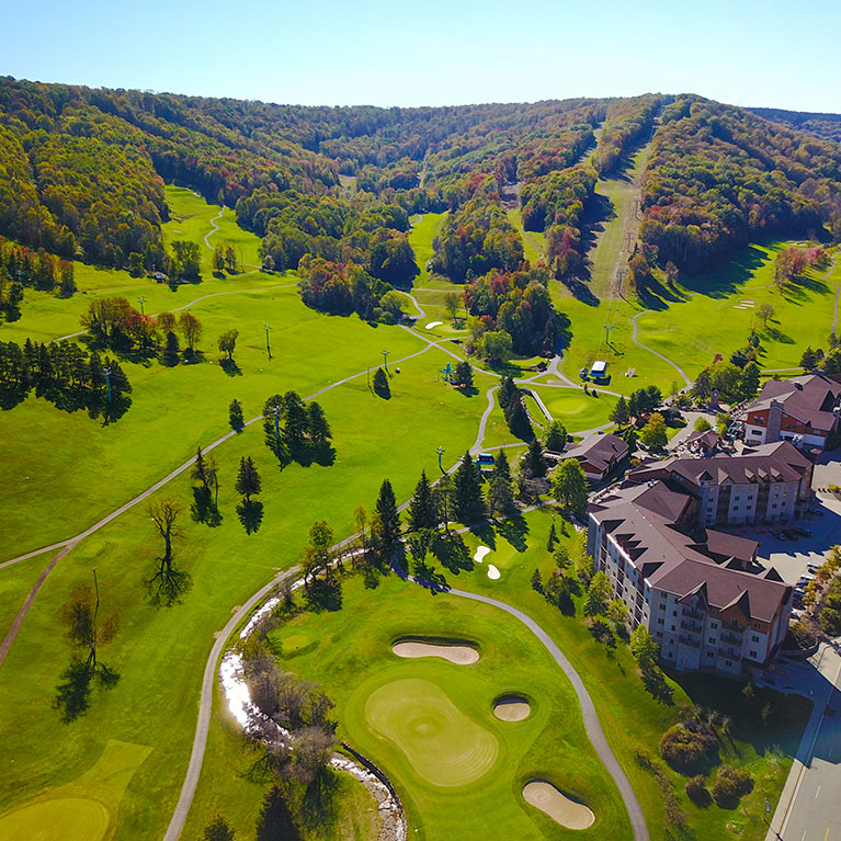 Aerial view of golf course and base lodge at Holiday Valley