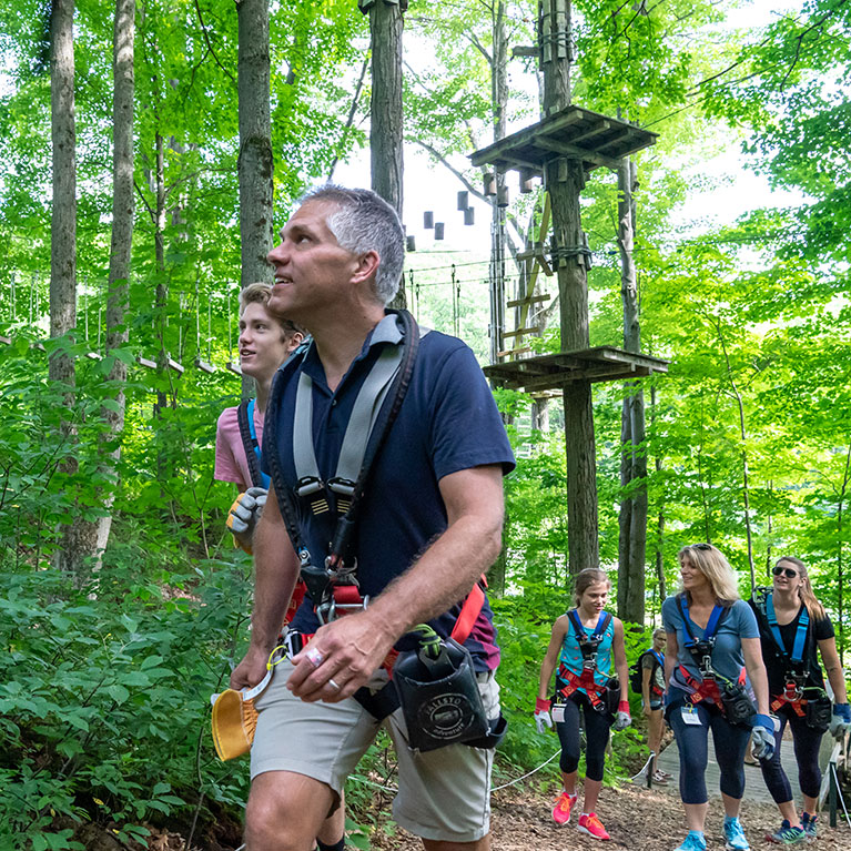 Zipline group walking through the forest