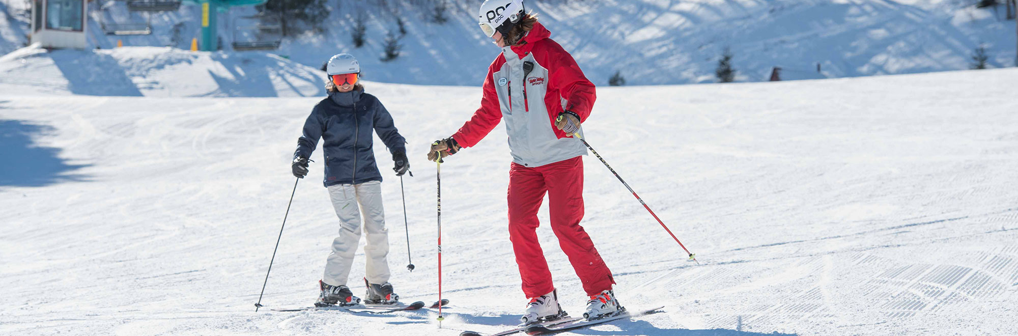 Ski Instructor teaching a student